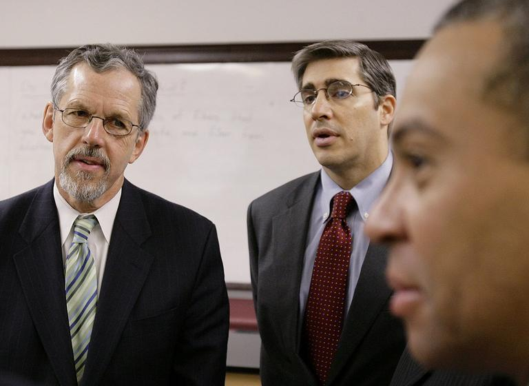 Gerald Chertavian, center, appears with Paul Reville, left, and Massachusetts Gov. Deval Patrick, right, at Monument High School in south Boston in 2008. (AP)