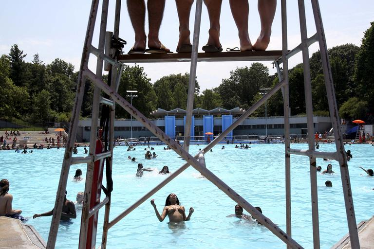 Lifeguards, top, watch over swimmers at Lasker Pool in New York. (AP)