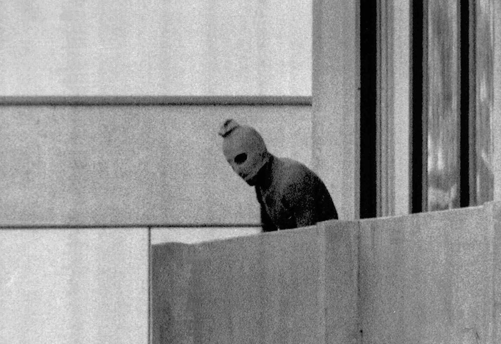 A Sept. 5, 1972 file photo shows a member of the Palestinian terrorist group who seized members of the Israeli Olympic team at their quarters at the Munich Olympic Village as the person appears with a hood over his face on the balcony of the village building where the hostages were held. (AP)