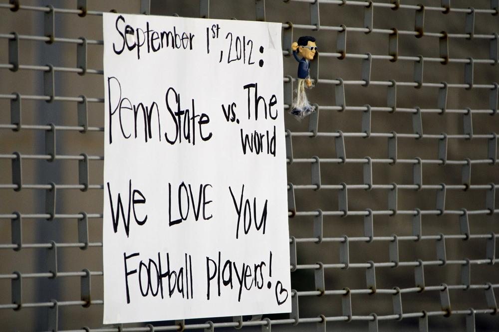 The NCAA's penalties against the Penn State football have sparked debates about fairness. This sign was on a gate outside Beaver Stadium on the PSU campus Monday. (AP)