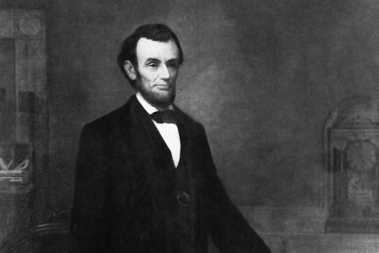President Abraham Lincoln is shown in a formal portrait, holding the 13th Amendment of the Constitution, year unknown. (AP)