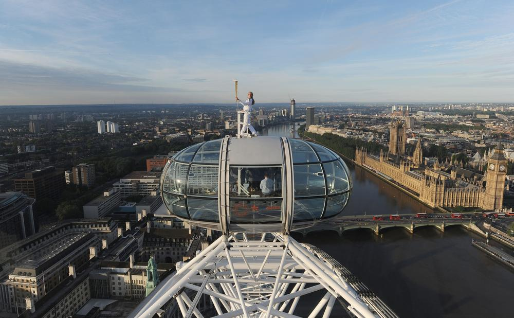 A new experiment will use the London Eye to serve as a barometer of public sentiment about the Olympics throughout the Games. (AP)