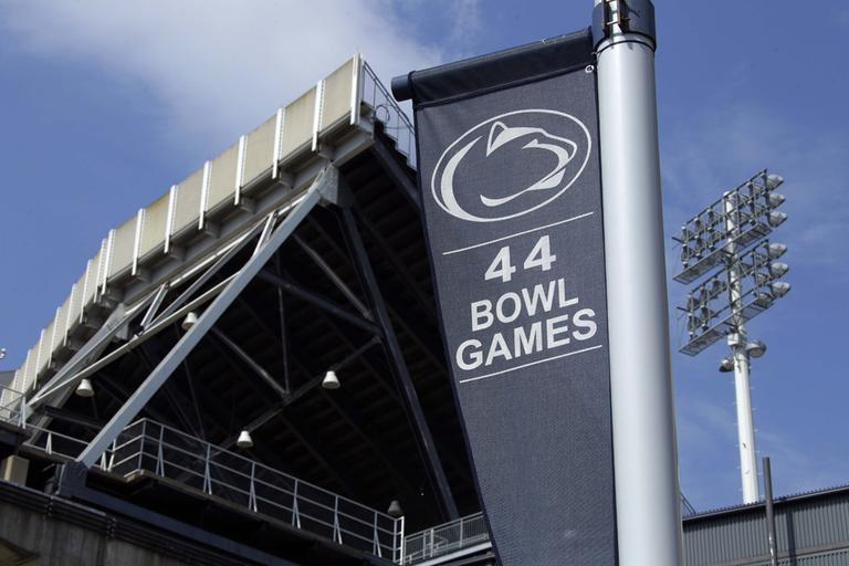 A banner celebrating the 44 bowl games that the Penn State football team has played in hangs outside of Beaver Stadium on the Penn State University main campus in State College, Pa. (AP)