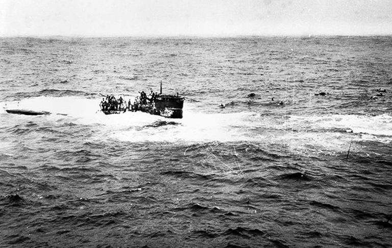 This April 16, 1944, photo provided by the U.S. Navy shows crewmen of the German U-550 submarine abandoning ship in the Atlantic Ocean after being depth charged by the USS Joyce, a destroyer. A team of explorers found the U-550 Monday about 70 miles south of Nantucket Island. (AP/U.S. Navy)