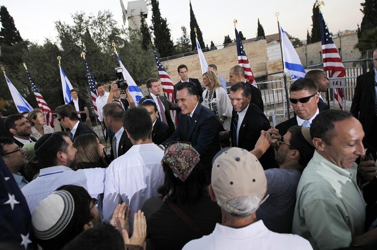 Republican presidential candidate and former Massachusetts Gov. Mitt Romney greets audience members after he delivered a speech in Jerusalem, on Sunday, July 29, 2012. (AP Photo/Charles Dharapak)