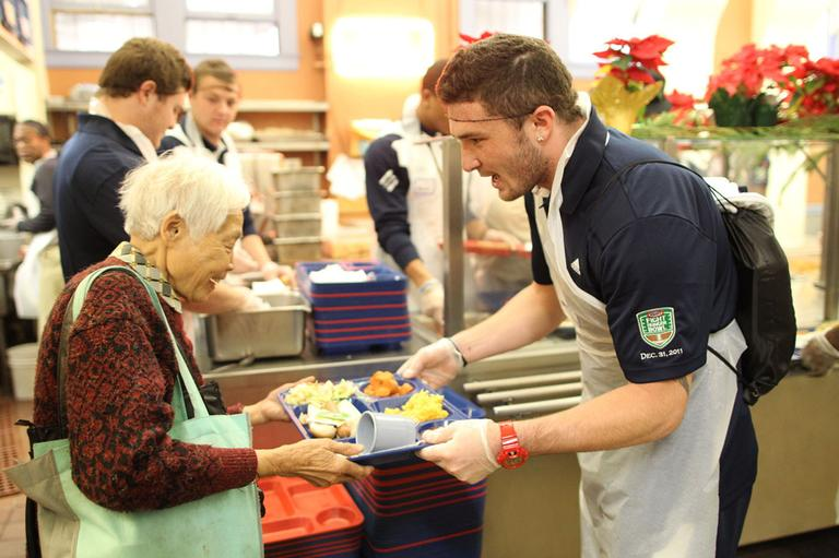 Junior LB David Allen joined teammates and coaches from UCLA in an effort to give back to the Bay Area community and fight hunger by visiting Glide Memorial Church & Kitchen on Friday, December 30, 2011. (AP)