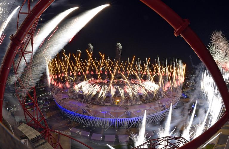 Fireworks over Olympic Stadium during the Opening Ceremony Saturday, in London (AP)