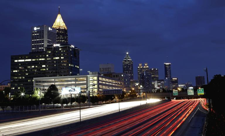 Traffic moves along Interstate 75 against the downtown skyline in Atlanta. (AP)