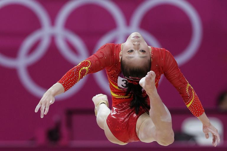 Chinese gymnast Sui Lu performs on the balance beam during the Artistic Gymnastic women's qualifications at the 2012 Summer Olympics, Sunday, July 29, 2012, in London. (AP)