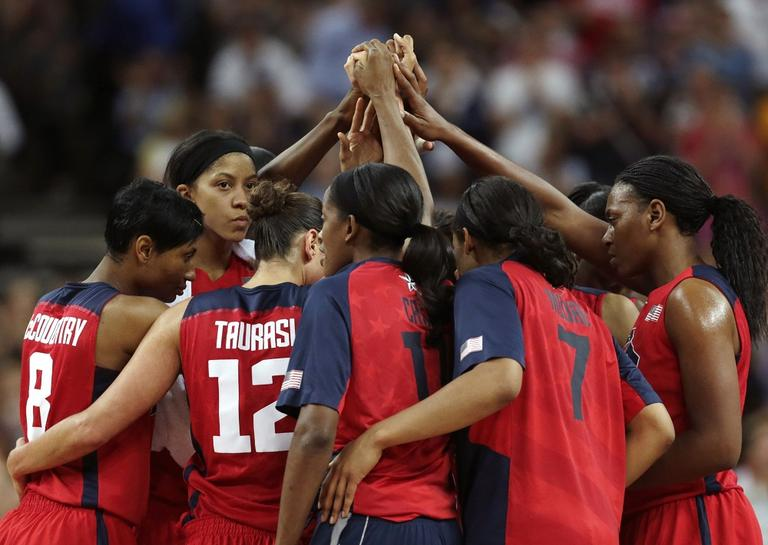 Team USA gather at half court after beating Australia during a women's semifinals basketball game at the 2012 Summer Olympics on Thursday. They will play in the Gold Medal Game on Saturday. (AP Photo/Charles Krupa)