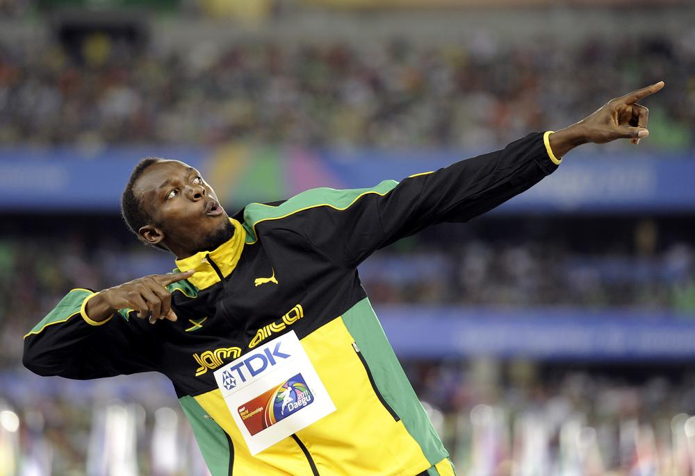 Jamaica's Usain Bolt posing on the podium after the Jamaican team won the gold and set a new world record in the men's 4x100m relay final at the World Athletics Championships in Daegu, South Korea. (AP)
