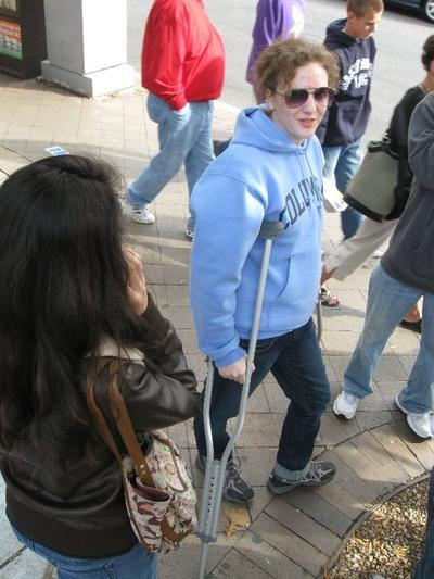 Annie donning a pair of crutches to get around at the Jon Stewart march on the Natl Mall, October 2010 . (Courtesy: Annie Ropeik)
