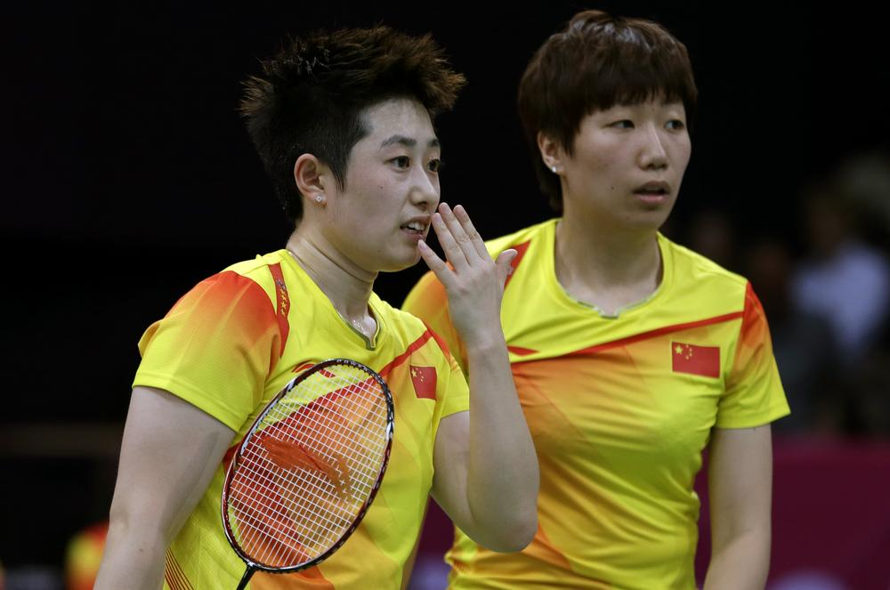 Eight Olympic badminton players, including China's Yu Yang, left, and Wang Xiaoli, were disqualified for tanking matches to get more favorable tournament positions. (AP)