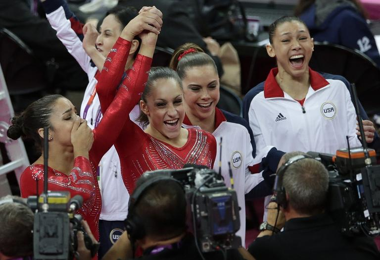 U.S. gymnasts, from left to right, Alexandra Raisman, Jordyn Wieber, McKayla Maroney and Kyla Ross celebrate after being declared winners of the gold medal during the Artistic Gymnastic women's team final at the 2012 Summer Olympics on Tuesday. (AP)