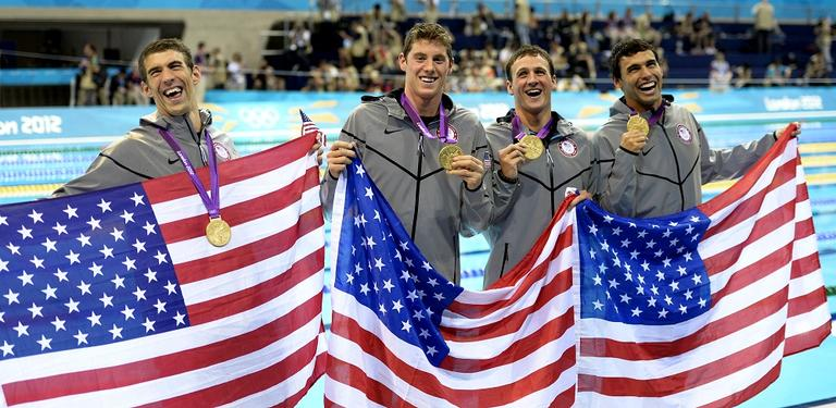 From left, United States' swimmers Michael Phelps, Conor Dwyer, Ryan Lochte and Ricky Berens pose with their gold medals for the men's 4x200-meter freestyle relay in the 2012 Summer Olympics in London on Tuesday. (AP)