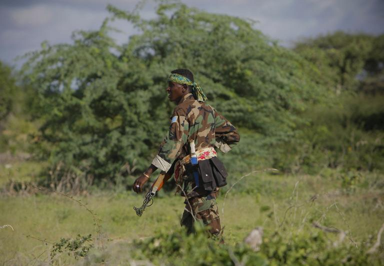 A soldier with the Somali National Army (SNA) walks along a road near Deyniile, Somalia, during a joint AMISOM and Somali National Army (SNA) operation to seize and liberate territory from the al-Qaeda affiliated extremist group al-Shabaab. (AP)
