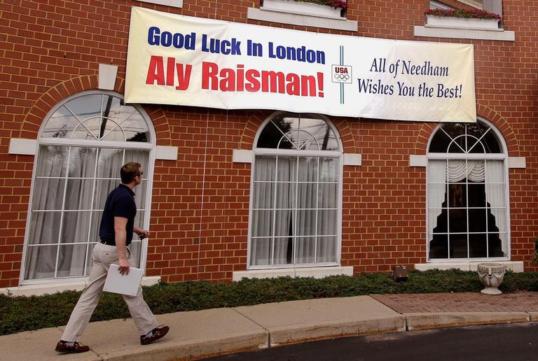 A sign hangs on a Needham building with a message of support for Aly Raisman. (AP)