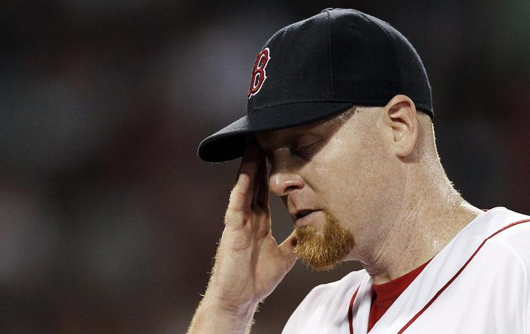 Red Sox starting pitcher Aaron Cook wipes his face while leaving the game after giving up five runs to the Detroit Tigers during the fifth inning. (AP Photo/Winslow Townson)