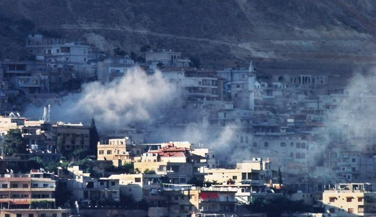 In this citizen journalism image provided by Shaam News Network SNN, smoke rises from purported shelling in Damascus, Syria. (AP Photo/Shaam News Network, SNN)