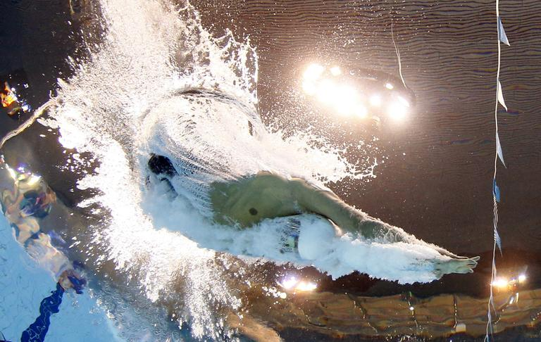 United States' Ryan Lochte starts in a men's 200-meter individual medley at the Aquatics Centre in the Olympic Park during the 2012 Summer Olympics in London, Wednesday, Aug. 1, 2012. (AP)