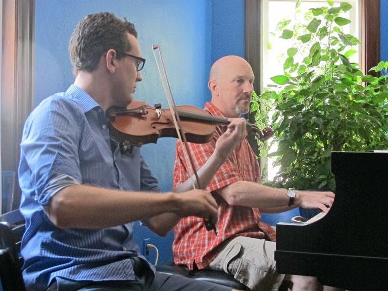 Ben Powell on violin and Tim Ryan on piano. (Andrea Shea/WBUR)