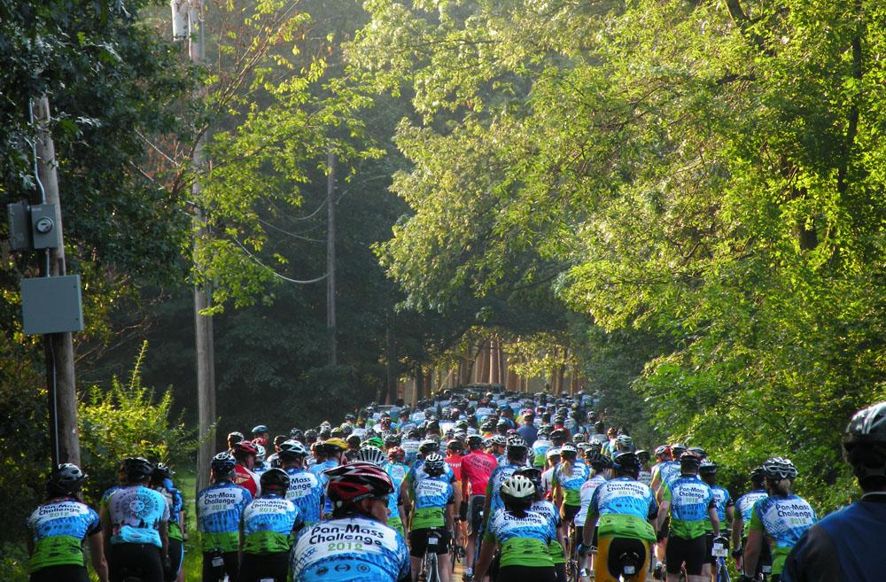 Riders leave Babson College campus for the first leg of the PMC. (Abby Elizabeth Conway for WBUR)