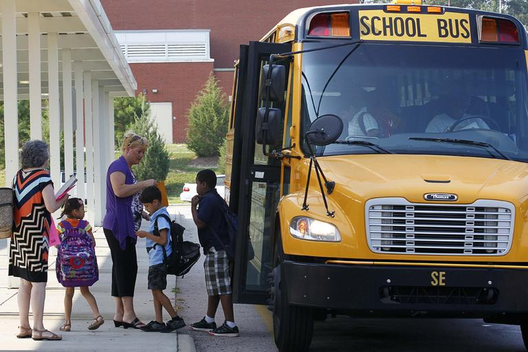 Students return for their first day of classes at Barwell Road Elementary School in Raleigh, N.C., Monday, July 9, 2012. (AP)