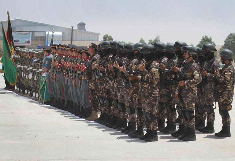 Afghan security forces stand in formation during the third phase of transfer of authority from NATO troops to Afghan security forces in Kandahar south of Kabul, Afghanistan on Wednesday, July 18, 2012. (AP Photo/Allauddin Khan)