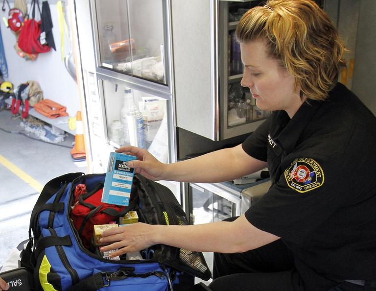 Salem fire department paramedic Jennifer Pratt checks over medications in an ambulance in Salem, Ore., Tuesday, July 10, 2012. (AP Photo/Don Ryan)