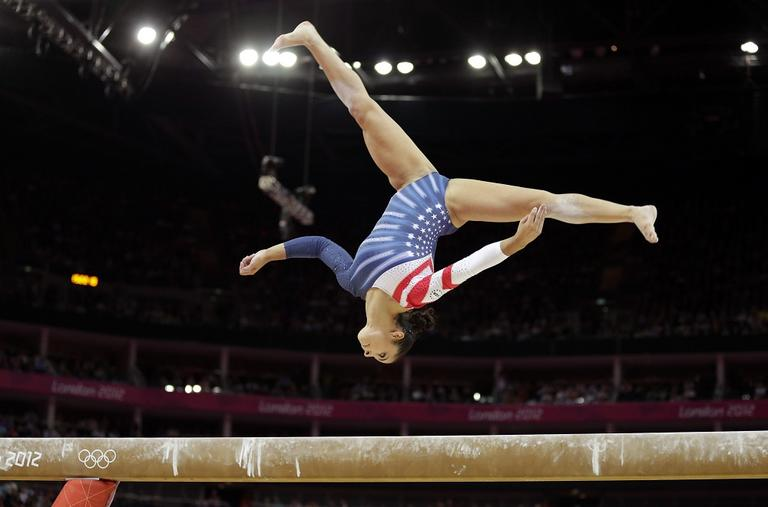 U.S. gymnast Alexandra Raisman performs on the balance beam during the artistic gymnastics women's apparatus finals at the 2012 Summer Olympics Tuesday. (AP)