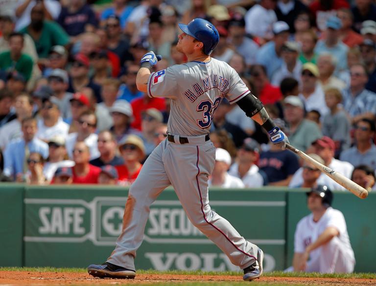 Texas Rangers' Josh Hamilton hits a two-run home run off a pitch by Red Sox starter Josh Beckett in the fifth inning Wednesday. (AP)