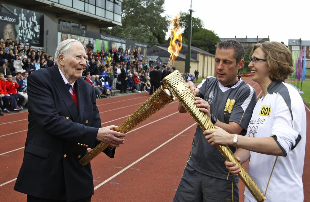 Britain's Sir Roger Bannister, left, broke the four-minute mile barrier in 1954, a feat that has lost some luster in today's track and field. (AP)