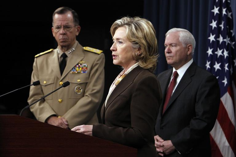 Secretary of State Hillary Rodham Clinton speaks to reporters about the Nuclear Posture Review as Chairman of the Joint Chiefs of Staff Adm. Michael Mullen and Defense Secretary Robert Gates look on, at the Pentagon in 2010. (AP Photo/Charles Dharapak)