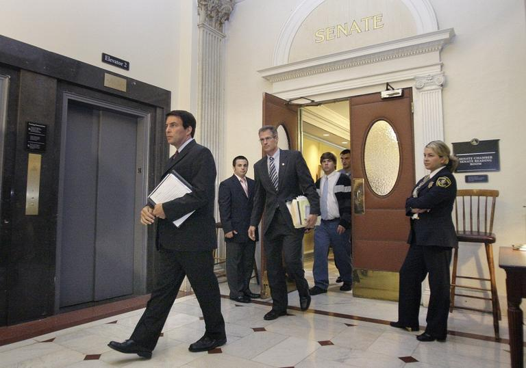 Richard Tisei, left, is followed by Sen. Scott Brown, as they leave the Senate Chambers in 2009. (AP)