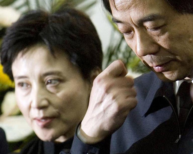 In this Jan. 17, 2007 file photo, Gu Kailai, left, wife of then Chinaese Commerce Minister Bo Xilai, right, attends a memorial ceremony for Bo's father. (AP)