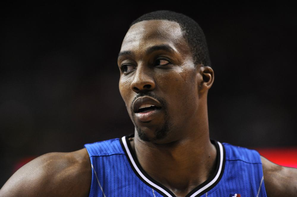 Dwight Howard is leaving Orlando to join the L.A. Lakers after a four-team trade that also sent Andre Iguodala from Philadelphia to Denver and Andrew Bynum from L.A. to Philly. (AP)