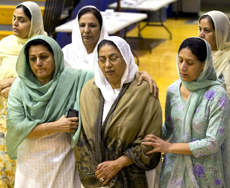 Mourners grieve at the funeral and memorial service for the six victims of the Sikh Temple of Wisconsin mass shooting in Oak Creek, Wis. (AP)