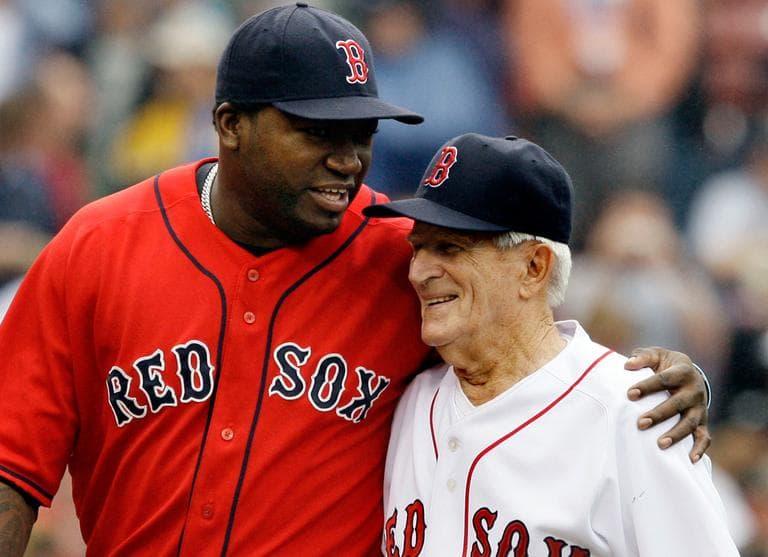 DH David Ortiz, left, hugs Sox legend Johnny Pesky during ceremonies retiring Pesky's No. 6 at Fenway Park, Sept. 28, 2008. (AP)