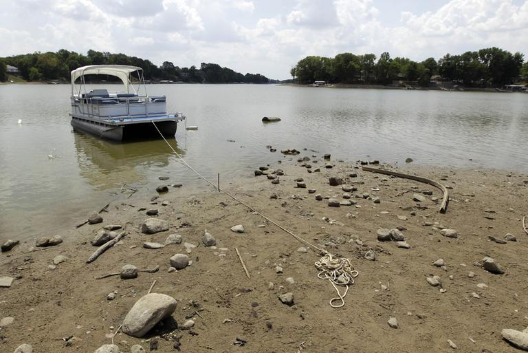 A pontoon is anchored on a mud flat as the owner could not reach their dock at Morse Reservoir in Noblesville, Ind. The reservoir is down nearly 6 feet from normal levels and being lowered 1 foot every five days to provide water for Indianapolis. (AP)