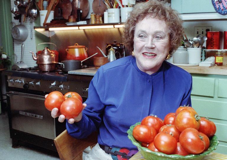 Chef Julia Child shows off tomatoes in the kitchen of her Cambridge home in 1992. (AP/File)