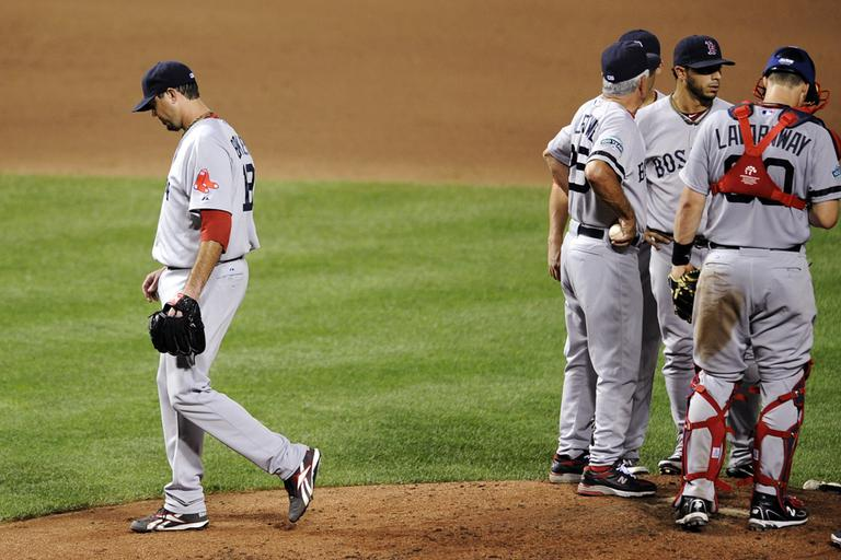 Josh Beckett exits the mound after he was pulled by manager Bobby Valentine during the sixth inning against the Baltimore Orioles Tuesday. (AP)