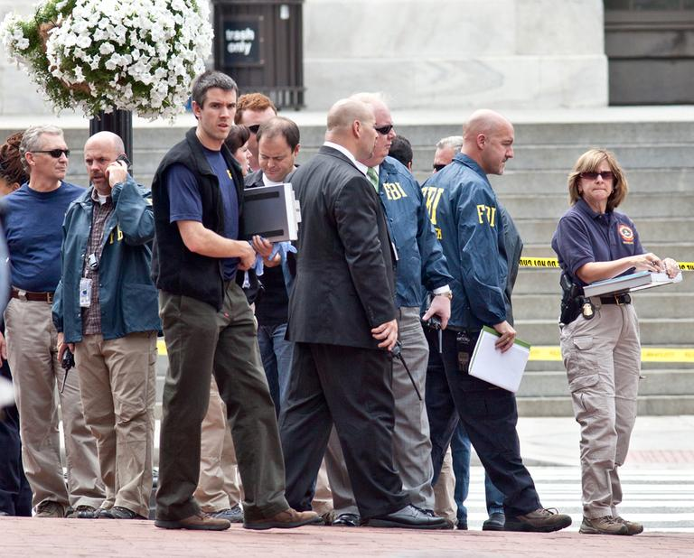 Washington Police and FBI agents gather outside the Family Research Council in Washington, Wednesday, after a security guard at the lobbying group was shot. (AP)