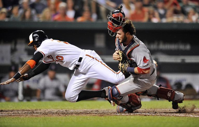 Baltimore Orioles' Adam Jones, left, and Red Sox catcher Jarrod Saltalamacchia collide at the plate in the sixth inning of a baseball game on Wednesday. (AP Photo/Gail Burton)