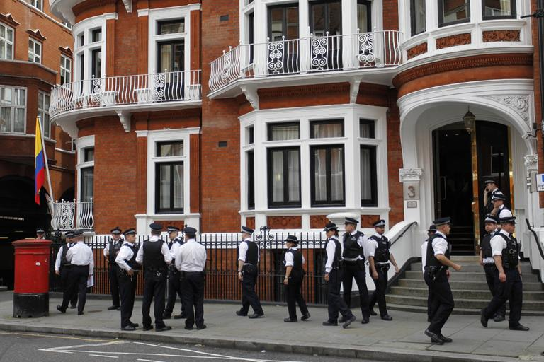 British police officers stand guard outside the Ecuadorian Embassy in central London, Thursday. (AP)
