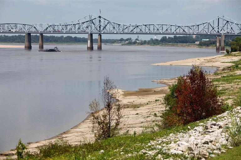 The banks of the Mississippi River near Vicksburg, Miss., continue to erode as the 2012 drought deepens. Barges are moving down the largest waterway in the U.S. with decreased loads and at slower speeds because of the risk of hitting debris or sand. (AP)
