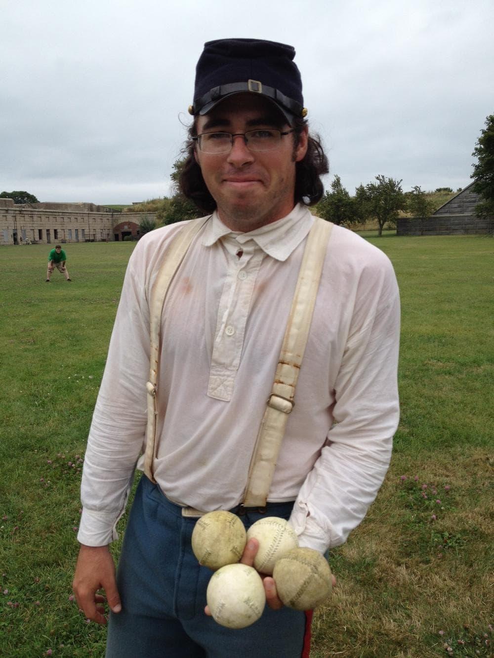 Jerry McCormack, a park ranger at Fort Warren on Georges Island, preps for a game of vintage baseball. (Melissa Galvez/WBUR)