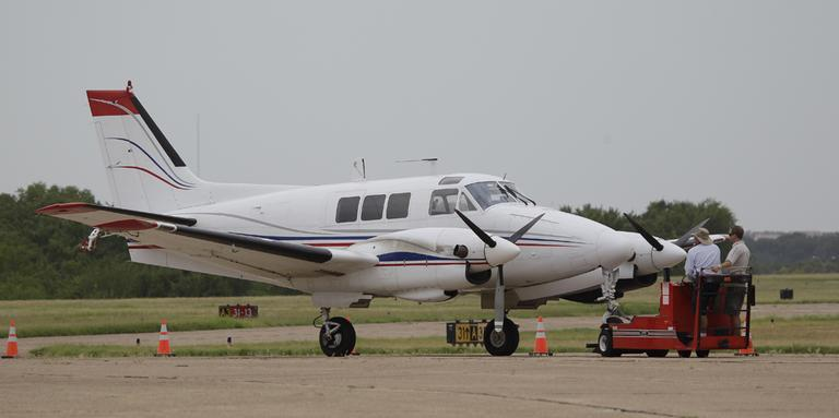 A plane for aerial spraying in Dallas. The last time Dallas used aerial spraying to curb the mosquito population, Texas' Lyndon Johnson was in the White House. (AP)