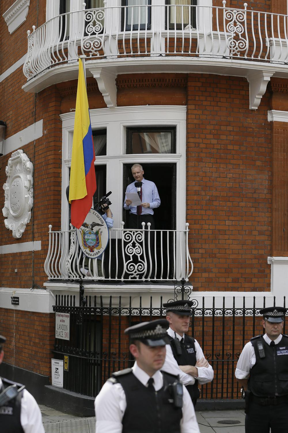 Julian Assange, founder of WikiLeaks, makes a statement from a balcony of the Equador Embassy in London. (AP)
