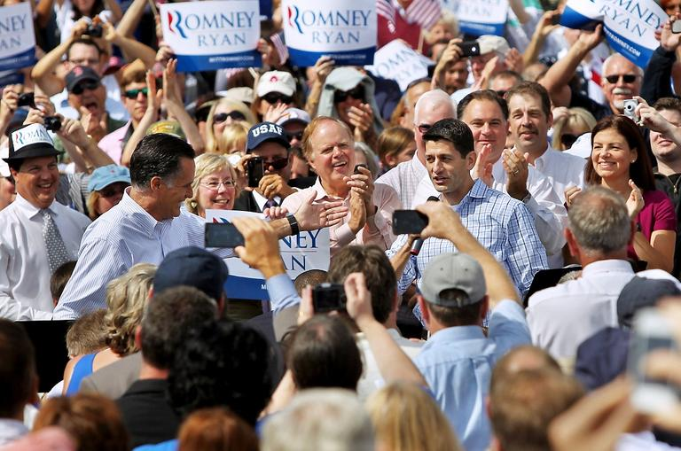 Republican presidential candidate Mitt Romney, left, introduces vice presidential candidate Rep. Paul Ryan on Monday at Saint Anselm College in Manchester, N.H. (AP)