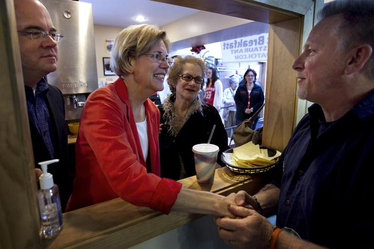 Elizabeth Warren, center, campaigns in Shrewsbury in April. With her, at left, is Rep. Jim McGovern. (AP)
